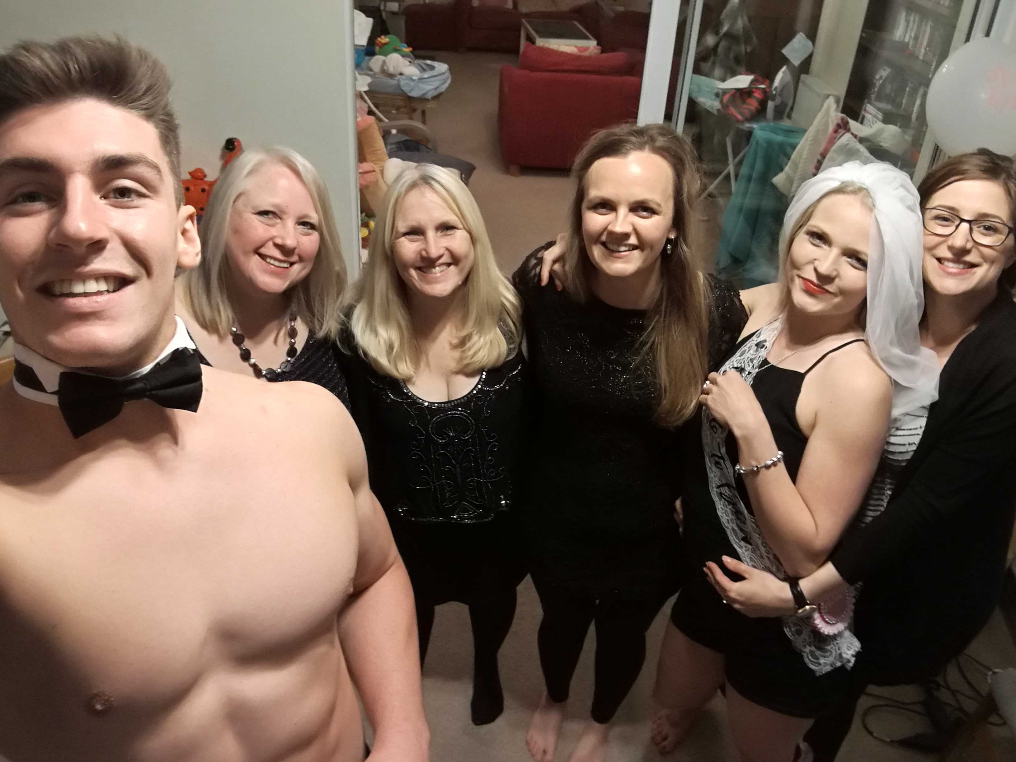 Butler in the buff group selfie