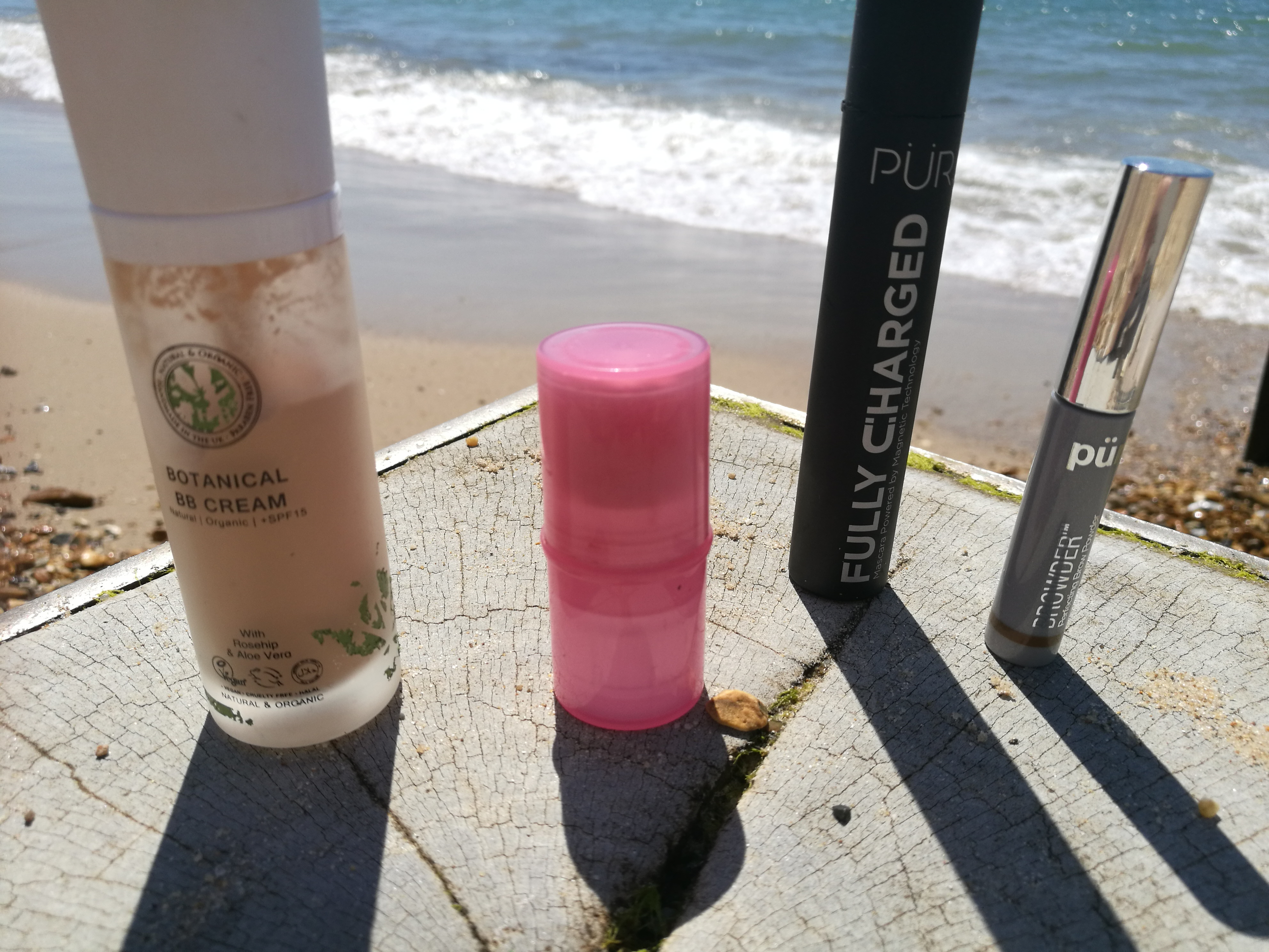 makeup products shoot by the sea